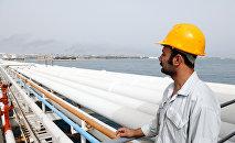 Иранский рабочий нефтегазовой сферы.