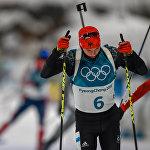 Немецкий биатлонист Бенедикт Долль на дистанции гонки преследования среди мужчин (12 февраля 2018). Пхенчхан, Южная Корея