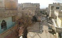 Гуманитарный коридор между Дамаском и Восточной Гутой в районе лагеря беженцев Вафидин в Сирии.