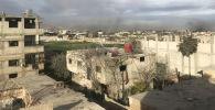 Дым, возникший в результате ударов сирийской армии по позициям Джебхат ан-Нусра (организация запрещена в РФ), в Восточной Гуте в пригороде Дамаска