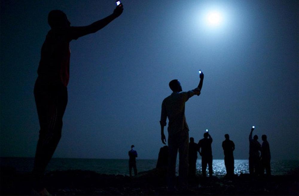 Фотография Джона Стенмайера, которая победила в фотоконкурсв World Press Photo 2014