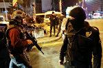 Полиция Турции на месте убийства посла России в Турции
