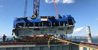СПУТНИК_Автобус с рабочими упал в море на Кубани. Съемка с места ЧП