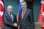 Президент России Владимир Путин (слева) и президент Турецкой республики Реджеп Тайип Эрдоган
