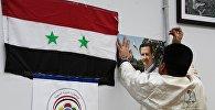 Флаг Сирийской Арабской Республики и портрет президента Башара Асада
